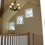 Attic remodel stairway with vaulted ceiling, Mission handrail and Marvin windows.