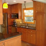 Edina kitchen with a cabinet depth refrigerator, undermount sink and numerous light sources.
