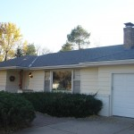Edina exterior with new architectural roof, seamless aluminum gutters and leaf free covers.