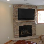 Minnetonka basement remodel with gas fireplace and stone surround.