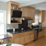 Minneapolis galley kitchen remodel with Maple cabinets and granite countertops.