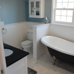 Attic remodel bathroom with Marble flooring and oil enameled woodwork.