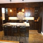 Edina basement remodel bar area and custom wood beam wrapping.