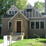 Minneapolis home with fresh stucco paint job, Marvin insert windows, Simpson wood door and leaf free gutters.