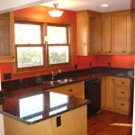 Maple cabinetry, granite countertops and new Oak flooring add warmth to this Minneapolis kitchen remodel.