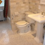 Minneapolis bathroom remodel done in the original style with marble subway tile and hex flooring.