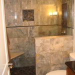 St Paul bathroom remodel with natural stone tile and custom cut glass enclosure.