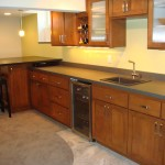 St Paul basement remodel with custom cabinets and elevated game table peninsula.