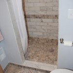 Minneapolis bathroom remodel with marble subway tile.