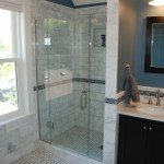 St Paul bathroom remodel with marble tile and glass shower enclosure.