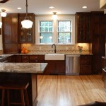 Minneapolis kitchen remodel combined with wall removal creating an open concept. Vintage styling throughout.