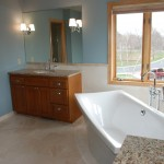 Minnetonka master bath remodel with soaking tub and dual vanities.