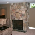Edina Basement remodel with gas fireplace and stone surround.