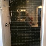 Minneapolis bathroom remodel with glass and ceramic subway tile plus a custom glass enclosure.