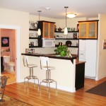 "We used a mixture of colors and materials to give this ""mother in law"" kitchen a modern feel."