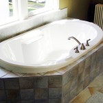 Built in whirlpool bathtub with stone tile work in Minneapolis bathroom remodel.