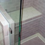 Custom tiled shower bench and heavy glass shower enclosure in Minneapolis.