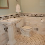 Bathroom remodel in Edina with Carrera marble subway tile, basket weave flooring and decorative boarders.