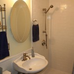 Bathroom remodel in the Crocus Hill neighborhood with white subway tile and Kohler fixtures.