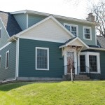 Full second story addition and side mud room addition in South Minneapolis. James Hardie siding, Timberline roof and Marvin windows throughout.