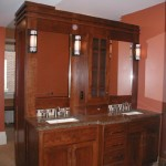 Custom made vanity with granite tops and built in dresser on rear side.