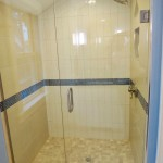 Walk in shower with custom glass enclosure.