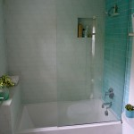 Minneapolis hall bathroom remodel with glass subway tile and custom glass shower enclosure.