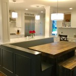 Edina kitchen remodel with white enameled cabinets and custom built in bench area.